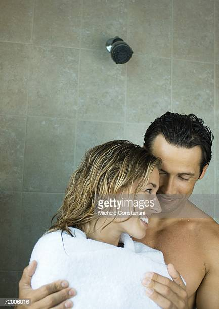 Couple drying off in shower