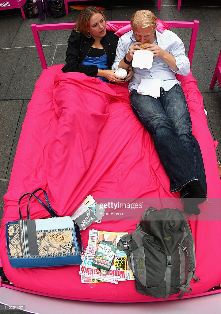 A couple eat breakfast in bed during the The World's Biggest Breakfast in Bed Guinness World Record Attempt at Martin Place on March 2, 2012 in Sydney, Australia.