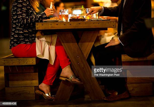 A couple eat dinner in the outdoor dinning area at Edmund's Oast in Charleston South Carolina on Wednesday March 11 2015