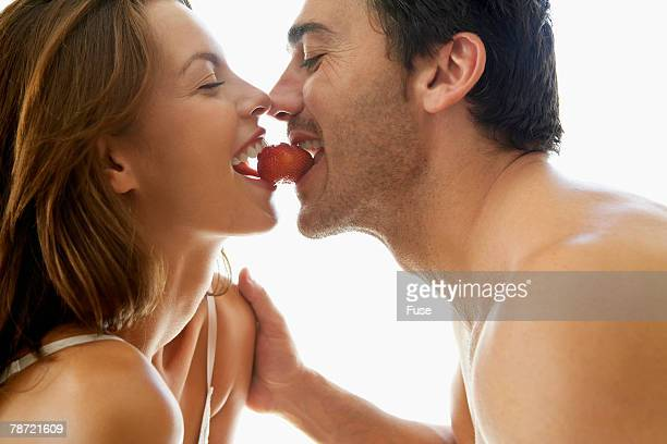 Couple Eating a Strawberry