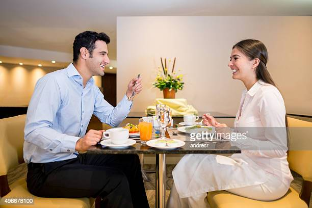 Couple eating at a hotel restaurant