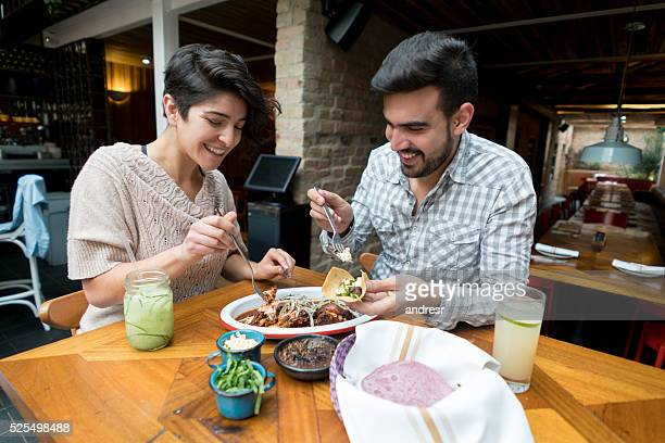 Couple eating at a Mexican restaurant