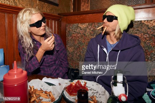 Couple eating bar food at a bar. : Stock Photo