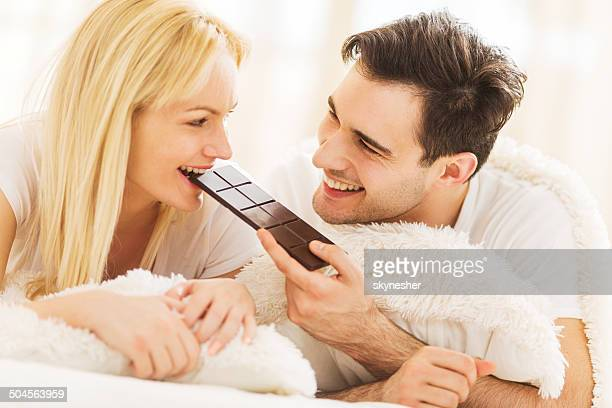 Couple eating chocolate.