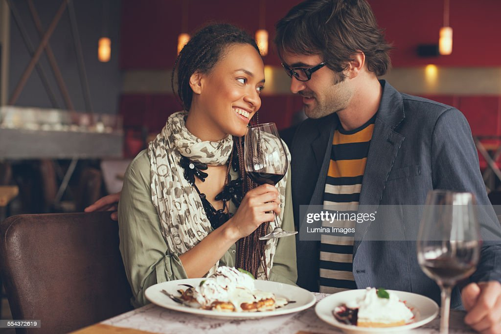 Couple eating dinner in cafe