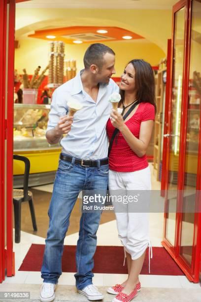 Couple eating ice cream cones