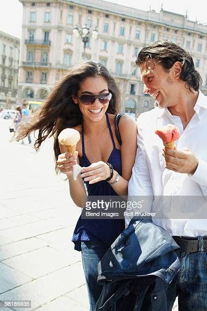Couple eating ice cream cones