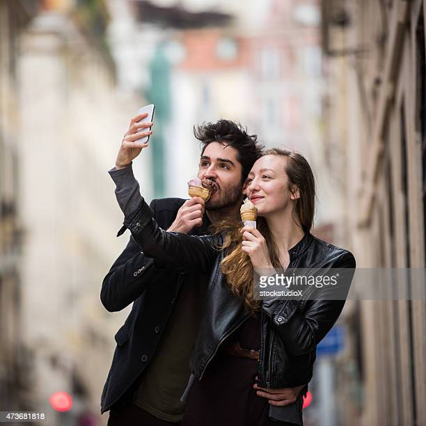 Couple eating ice cream taking selfie on European vacation