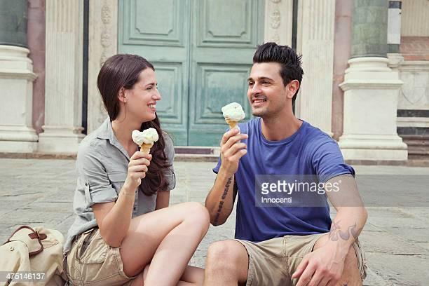 Couple eating ice creams, Santa Maria Novella square, Florence, Tuscany, Italy