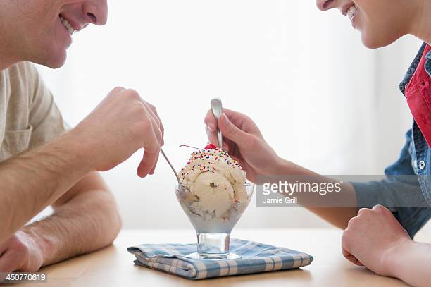 Couple eating one bowl of ice-cream