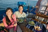Couple Eating Salad on Sailboat
