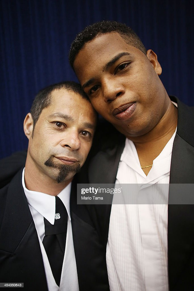 Couple Edinilson (R) and Glauco pose after marrying at what was billed as the world's largest communal gay wedding on December 8, 2013 in Rio de Janeiro, Brazil. 130 couples were married at the event which was held at the Court of Justice in downtown Rio. In May, Brazil became the third country in Latin America to effectively approve same-sex marriage via a court ruling, but a final law has yet to be passed.