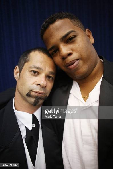 Couple Edinilson and Glauco pose after marrying at what was billed as the world's largest communal gay wedding on December 8 2013 in Rio de Janeiro...