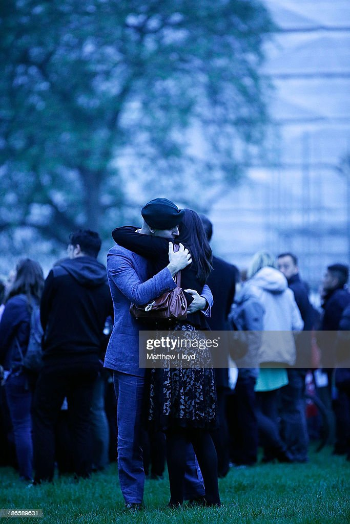 A couple embrace during a dawn remembrance service at the Wellington Arch on ANZAC Day at Hyde Park on April 25, 2014 in London, England. It is the 99th anniversary of the Galipoli landings in which tens of thousands of servicemen died.