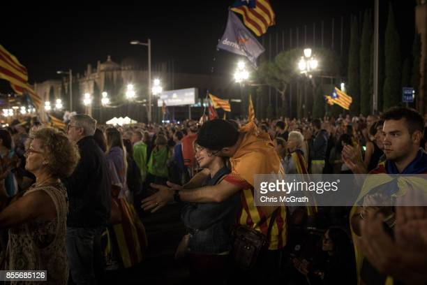 A couple embrace while attending the final proindependence rally at Plaza Espana ahead of Sunday's referendum vote on September 29 2017 in Barcelona...
