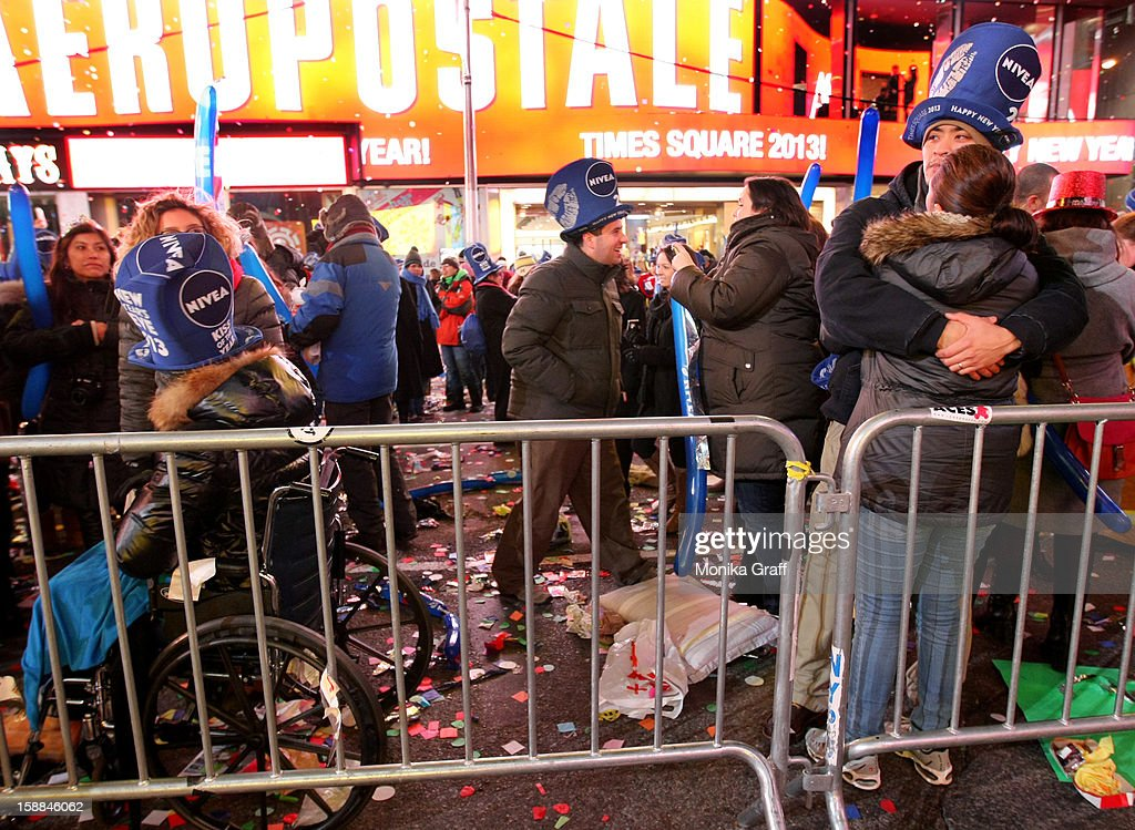 A couple embraces in Times Square for the annual New Year's Eve celebration on January 1, 2013 in New York City. Approximately one million people are expected to ring in the new year in Times Square.