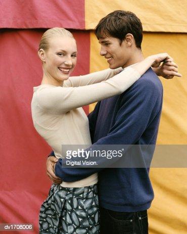 Couple Embracing by a Fairground Tent : Bildbanksbilder