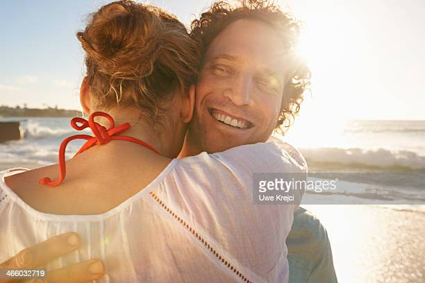 Couple embracing by the sea, close up