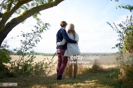 Couple embracing in countryside location. : Stock Photo
