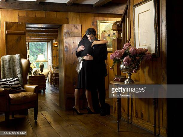 Couple embracing in foyer