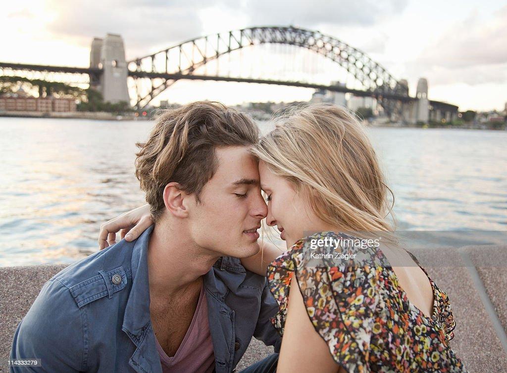couple embracing in front of Sydney Harbour Bridge : Stock Photo