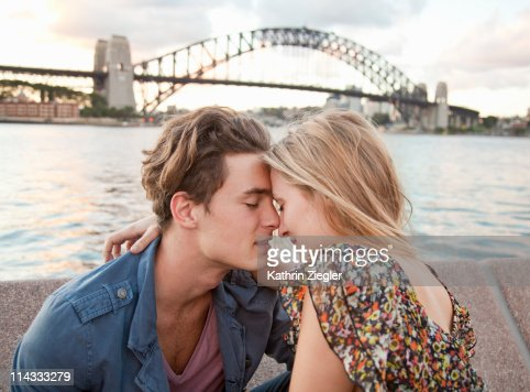 couple embracing in front of Sydney Harbour Bridge : Stock Photo
