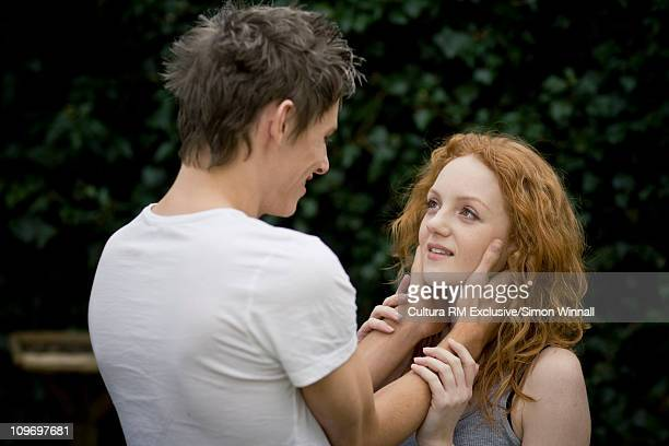 Couple embracing in garden