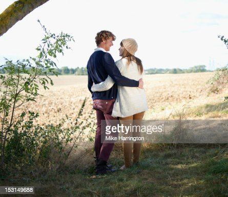 Couple embracing in idyllic countryside location. : Stock Photo