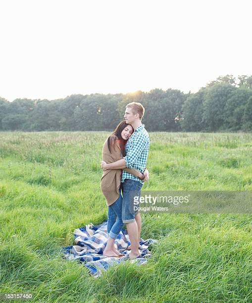 Couple embracing in idyllic Summer meadow.