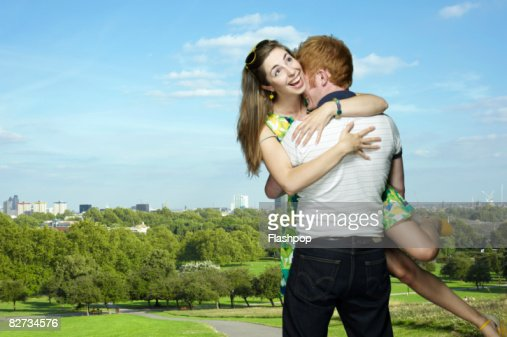 Couple embracing in park : Stock Photo