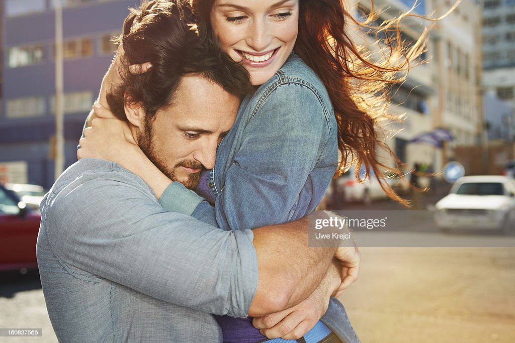 Couple embracing in the city : Stock Photo