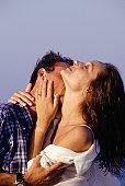Couple embracing, man kissing neck