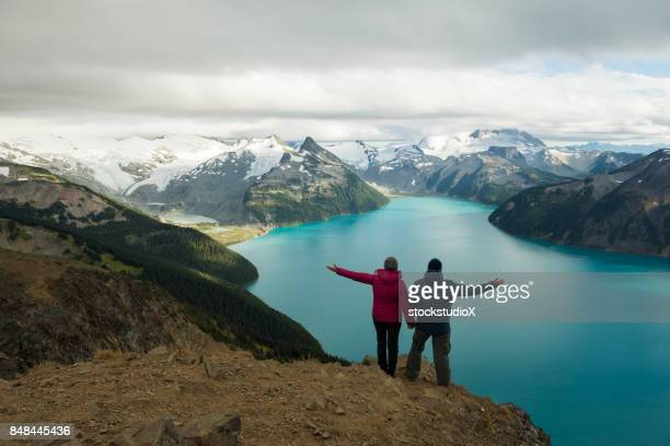 Couple embracing nature with open arms