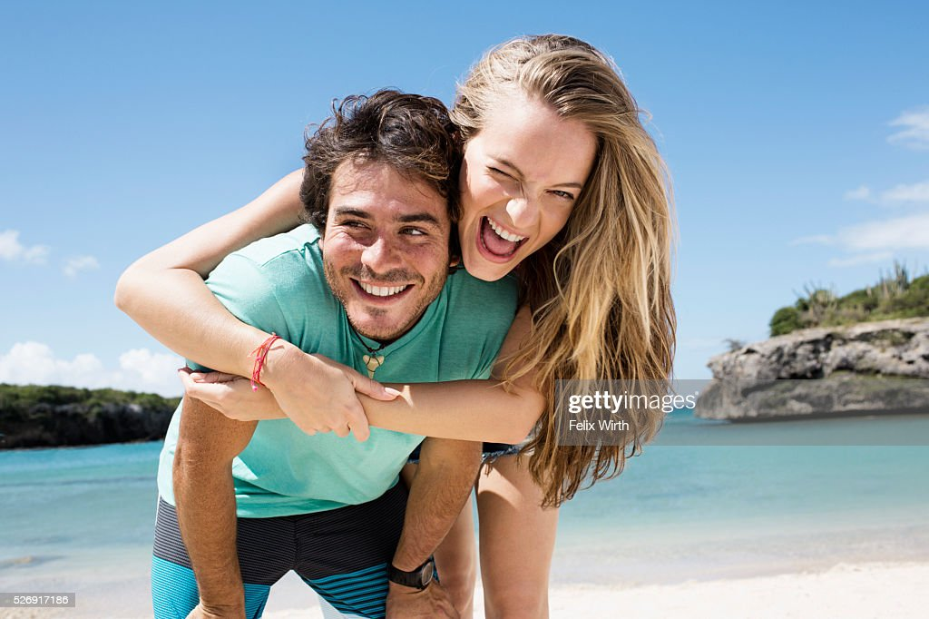 Couple embracing on beach : Photo