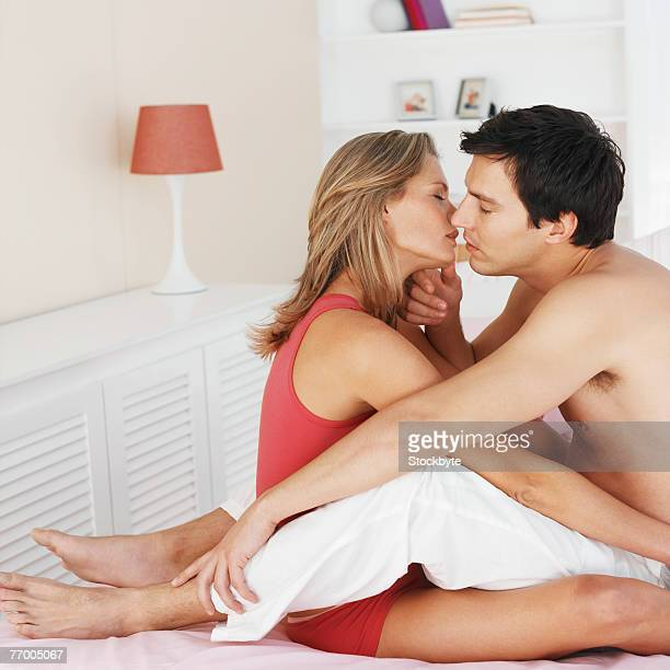 Couple embracing on bed