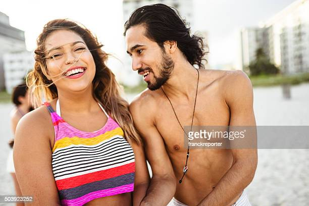 couple embracing on the beach for summer