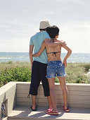Couple embracing, rear view