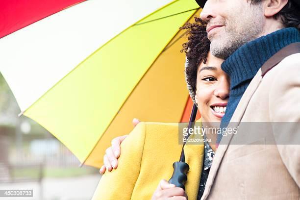 Couple embracing under an umbrella