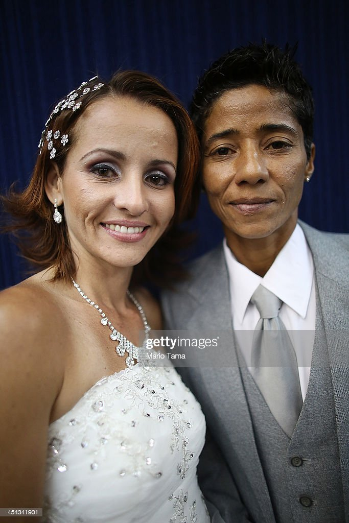 Couple Emmanuela and Romilda (R) pose before marrying at what was billed as the world's largest communal gay wedding on December 8, 2013 in Rio de Janeiro, Brazil. 130 couples were married at the event which was held at the Court of Justice in downtown Rio. In May, Brazil became the third country in Latin America to effectively approve same-sex marriage via a court ruling, but a final law has yet to be passed.