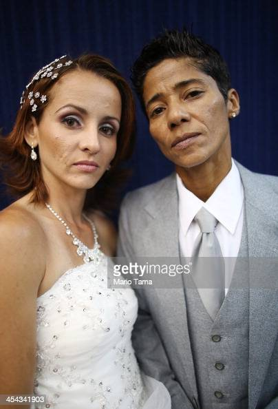 Couple Emmanuela and Romilda pose before marrying at what was billed as the world's largest communal gay wedding on December 8 2013 in Rio de Janeiro...