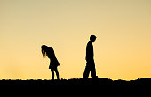 Silhouette of a couple ending relationship / Couple break up