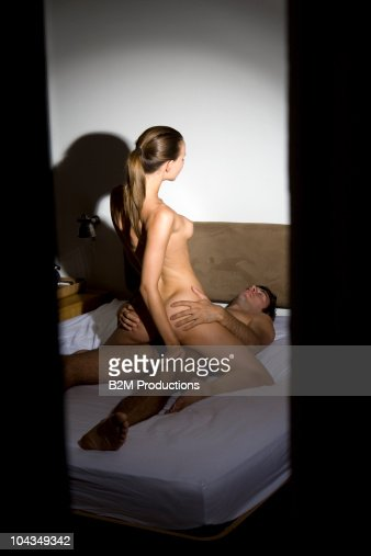 Couple engaged in sexual intercourse on bed : Stock Photo