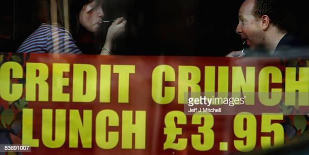 A couple enjoy a credit crunch lunch at a pub in Edinburgh on November 14 2008 in Edinburgh Scotland With a high likelihood of the Scottish economy...