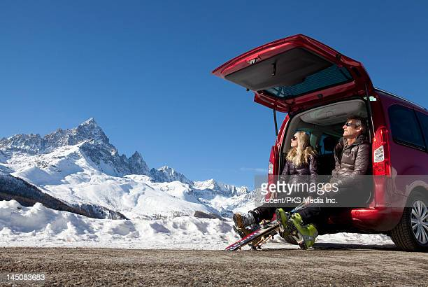 Couple enjoy sun from tailgate, apres skiing