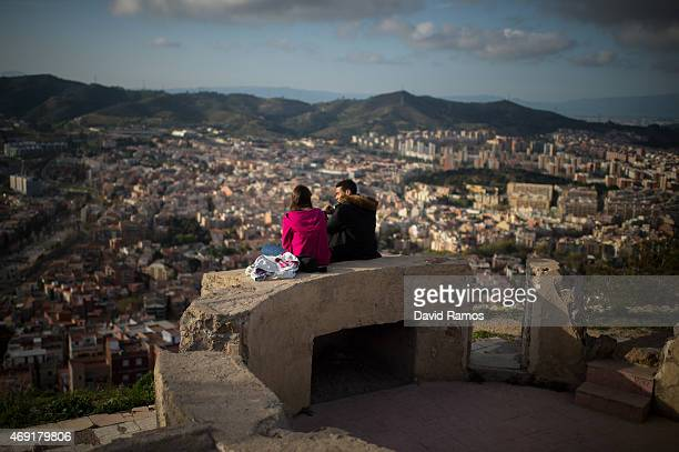A couple enjoy the views over the city from old antiaircraft batteries built to defend the city during the Spanish Civil war on April 10 2015 in...