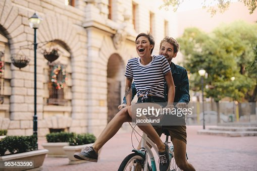 Couple enjoying a bicycle ride in the city : Stock Photo