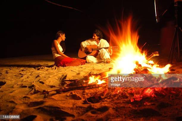 Couple enjoying a bonfire