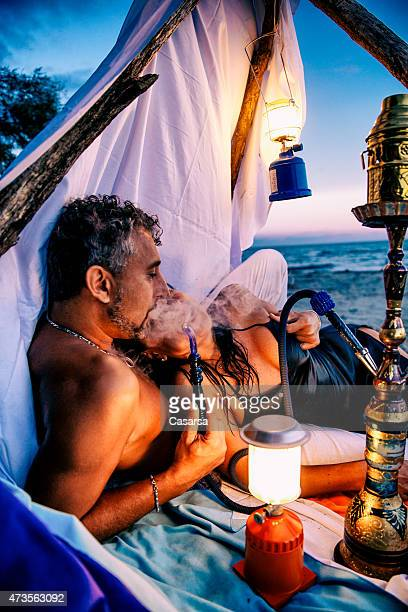 Couple enjoying a Hukah on the beach