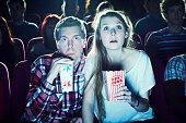 couple enjoying a movie at the cinema