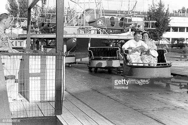 A couple enjoying a ride at Buckeye Lake Amusement Park Near Columbus Ohio Summer 1938